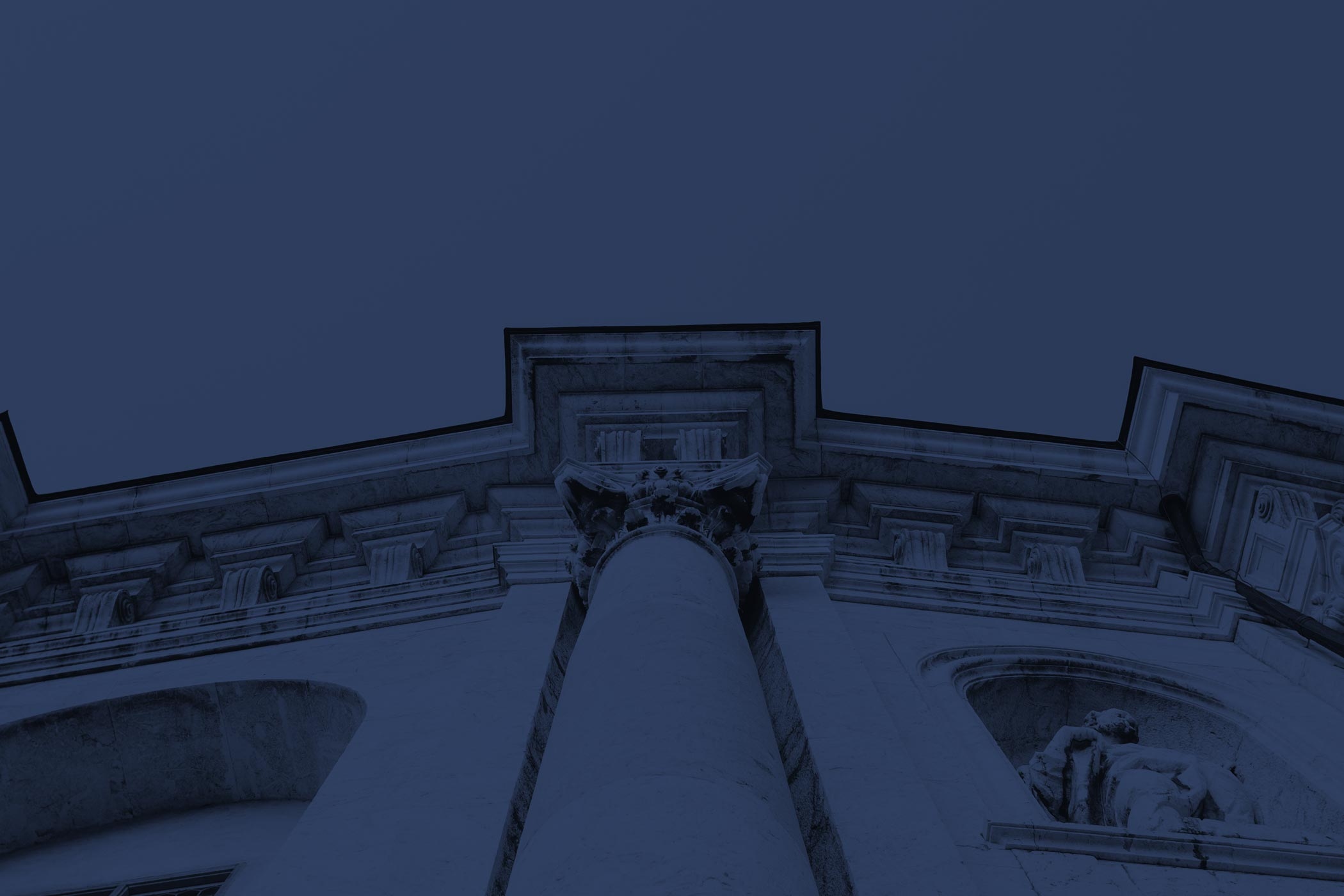 Upward view of what appears to be a courthouse